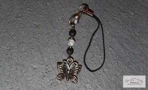 Schmetterling mit Lava und Türkis